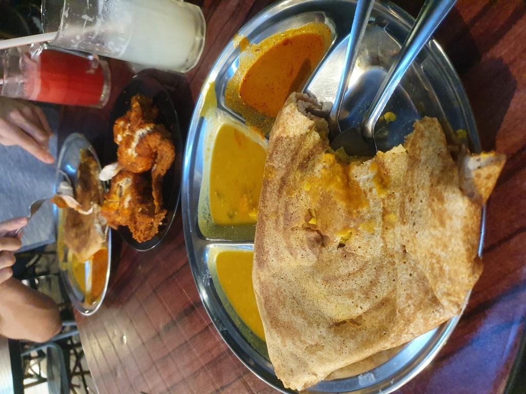 Breads, curries and chicken at a Kedai Mamak Husin in Bukit Bintang