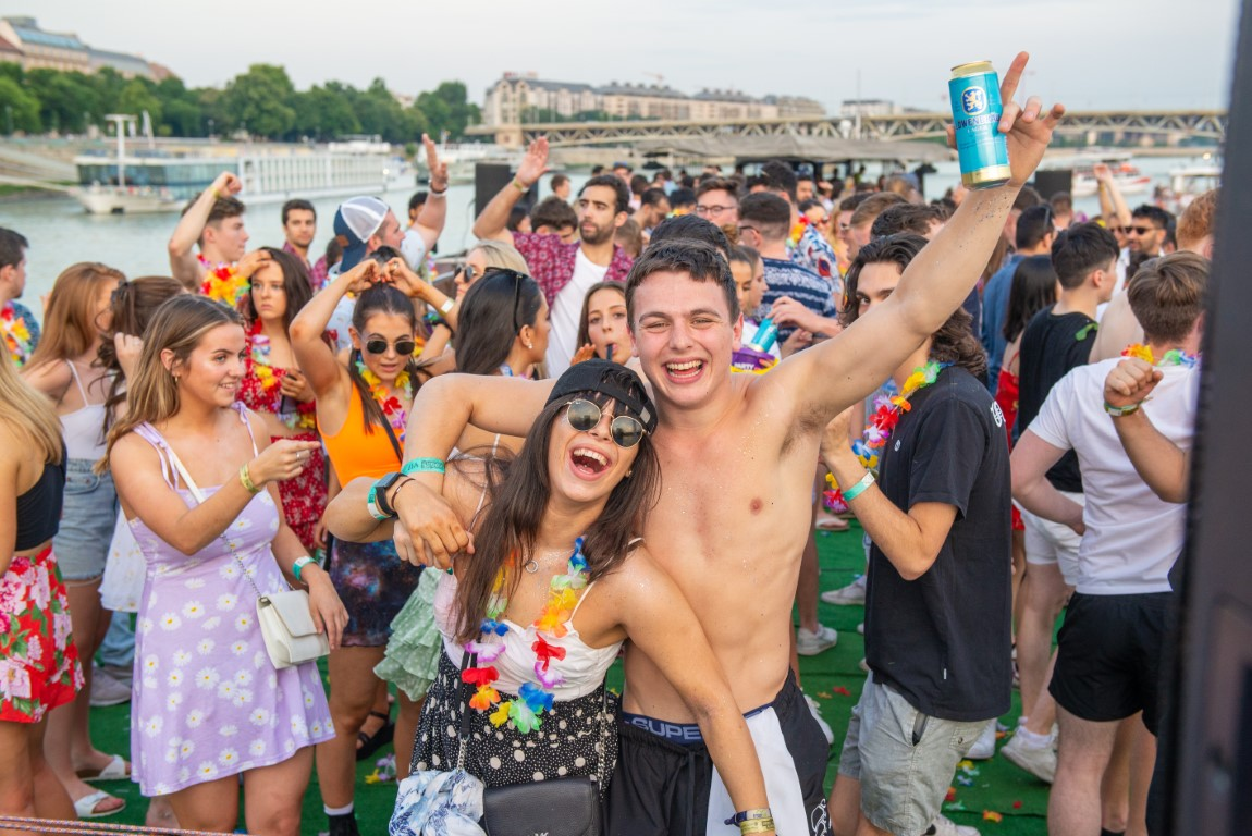 a group of people partying during the day on the river in budapest