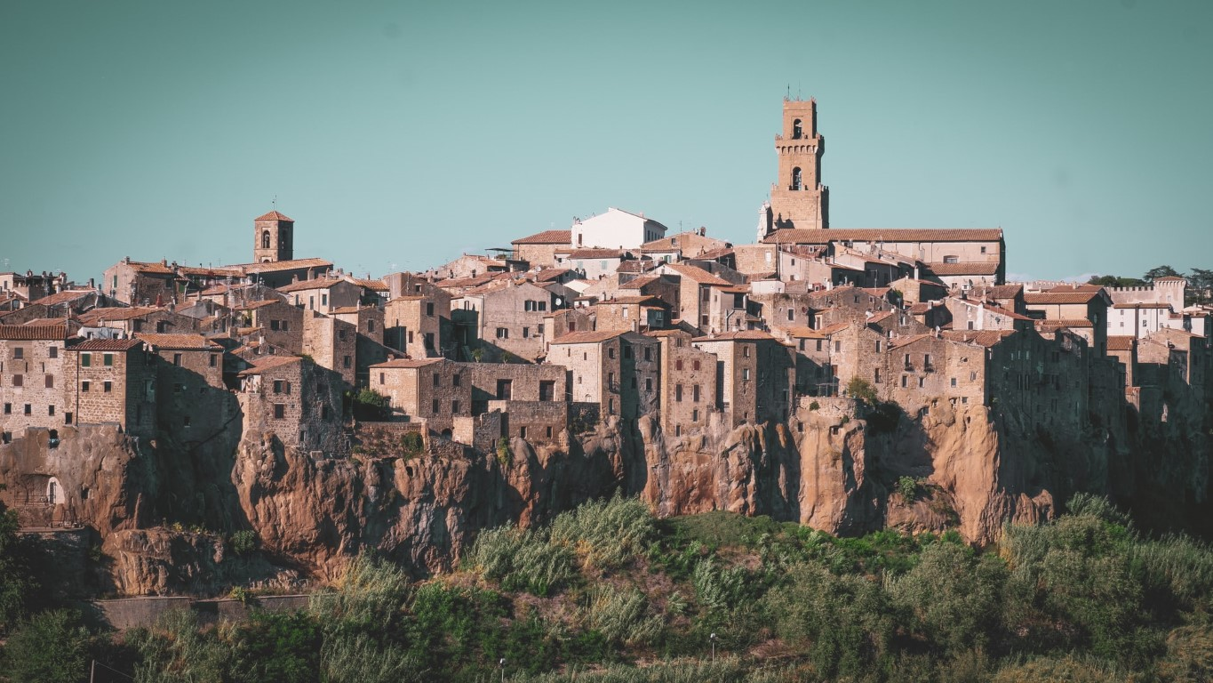 View of Pitigliano, Italy from a far with it's brown stucco buildings