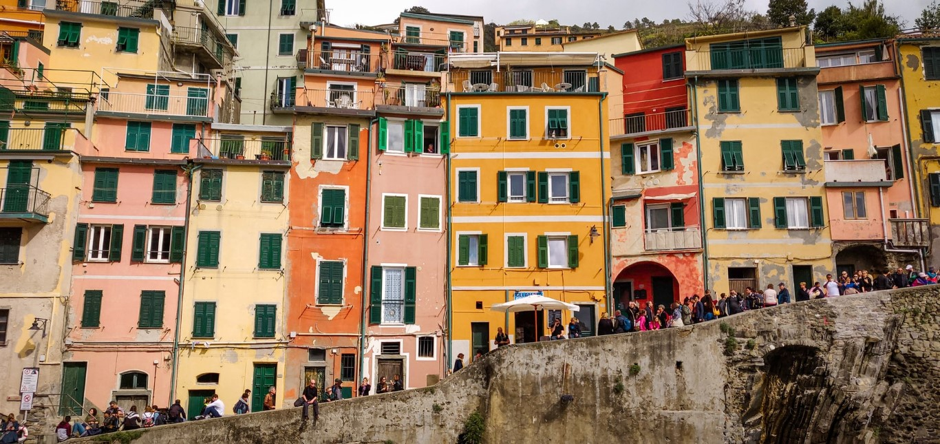 A picture of a row of colourful houses in Riomaggiore, Italy in Cinque Terre