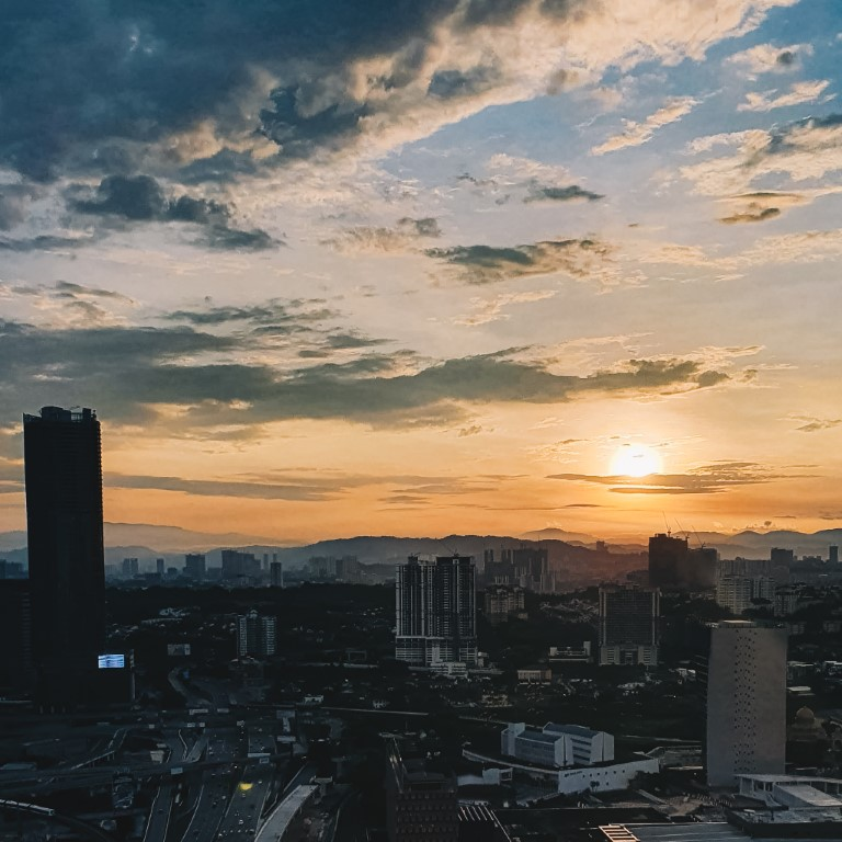a beautiful sunrise over the city of Kuala Lumpur on a clear morning