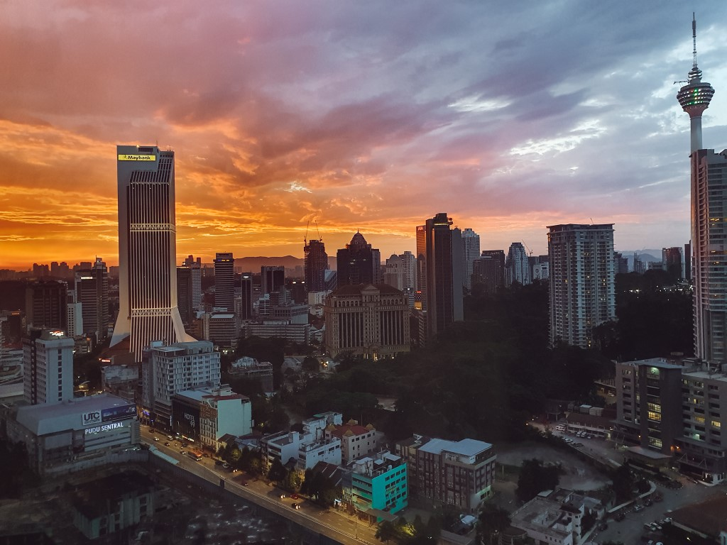 an incredibly vibrant orange sunset from a high rise in kuala lumpur, malaysia