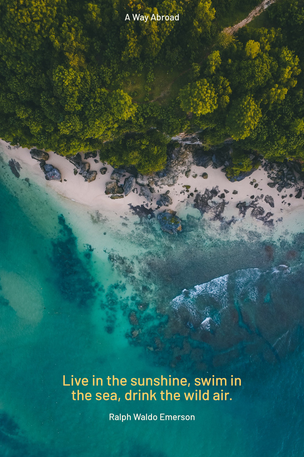 drone picture of a rocky coast covered in trees with a ralph waldo emerson quote
