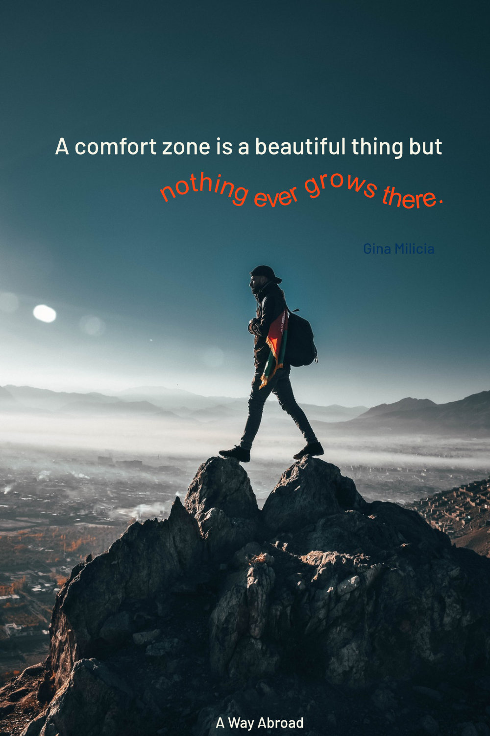 man walking on top of a mountain peak on a bright blue sky with a quote to get out of your comfort zone