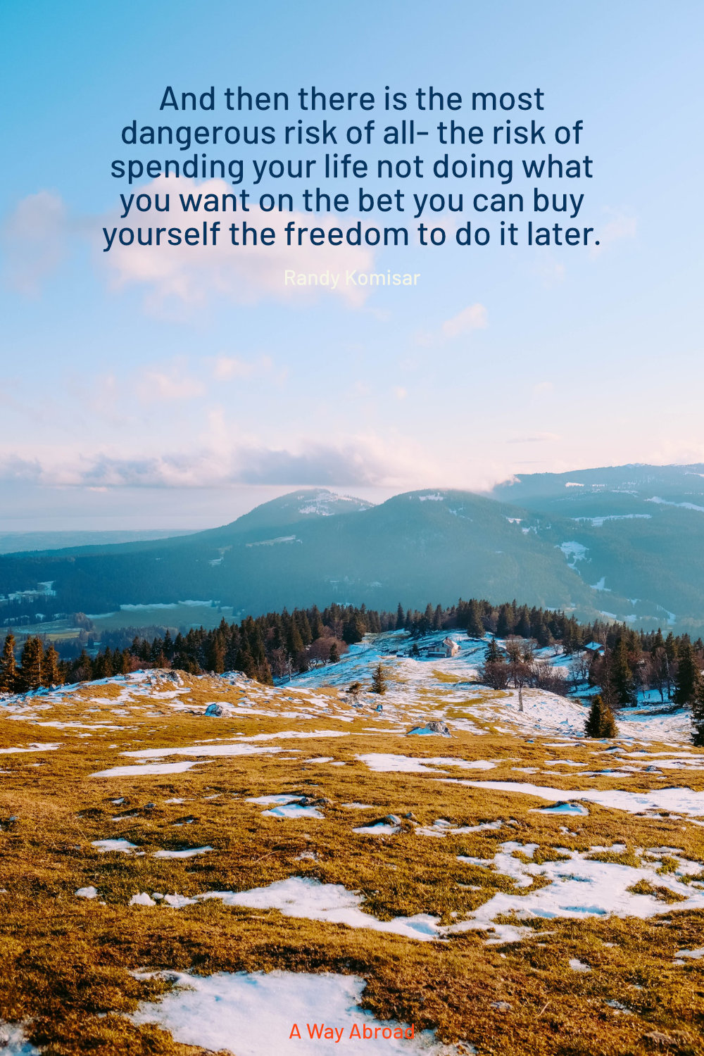 a snowy hilltop overlooking more hills with a motivational quote to live the life you dream of