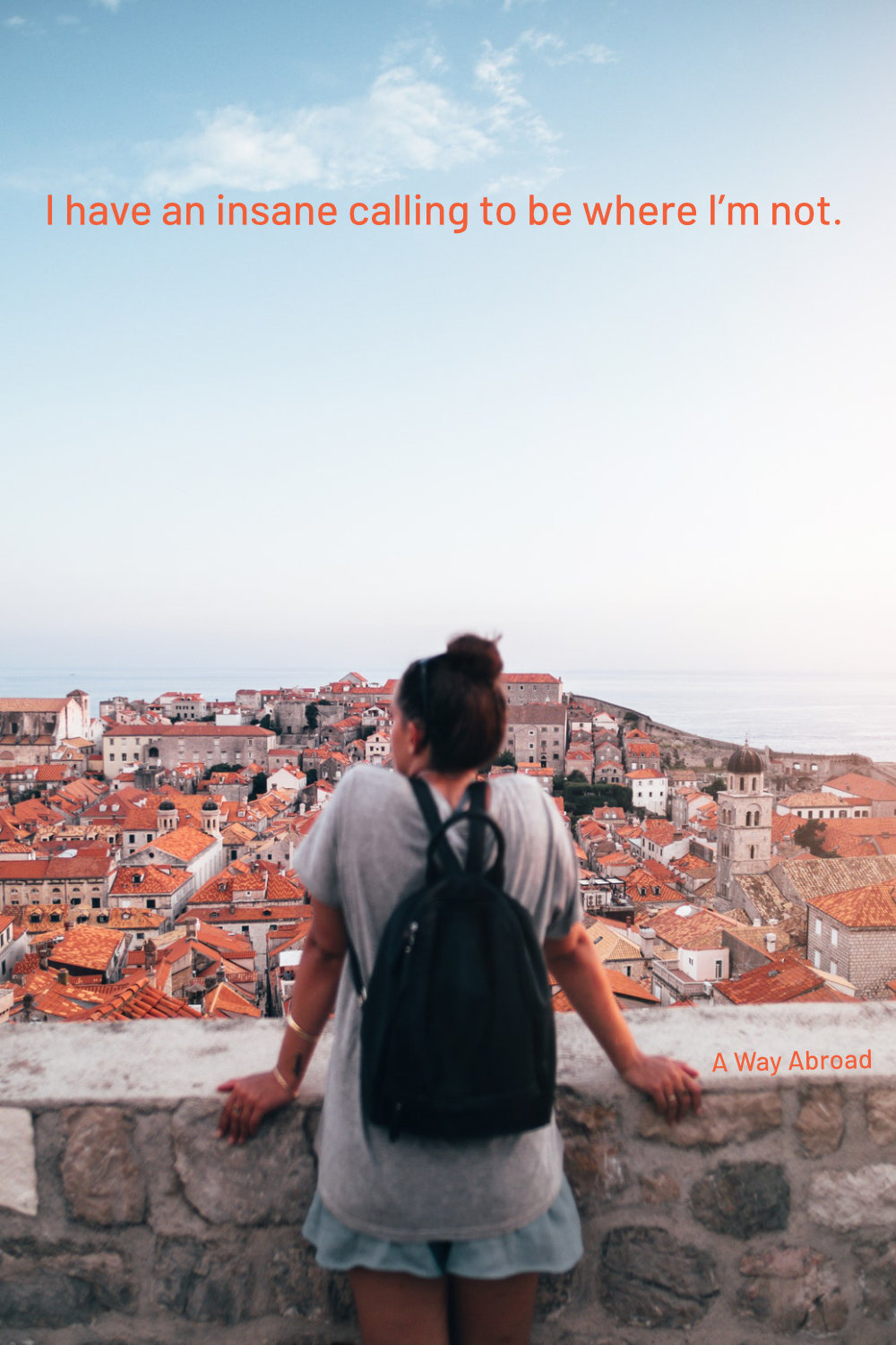 woman overlooking the coast of Portugal with houses below and a travel quote