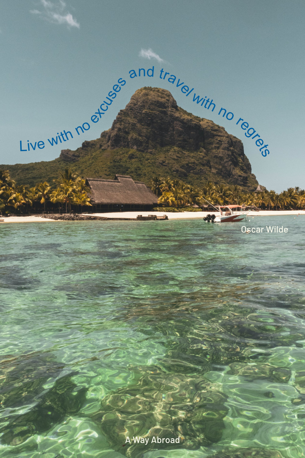 Mauritius rocky coastline with boats and a travel quote