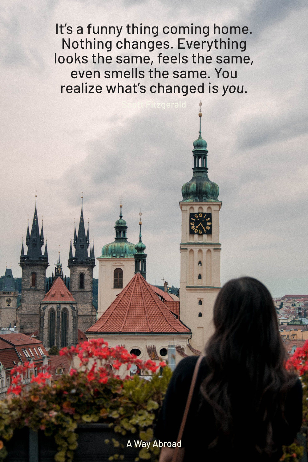 a woman overlooking a historic building in the Czech Reublic