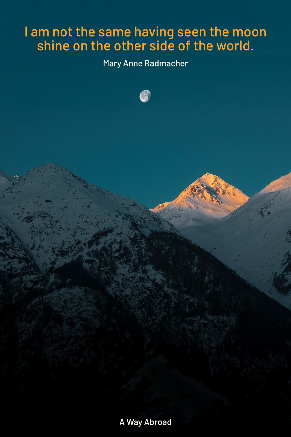 mountains at sunset with the moon already visible above mountain range