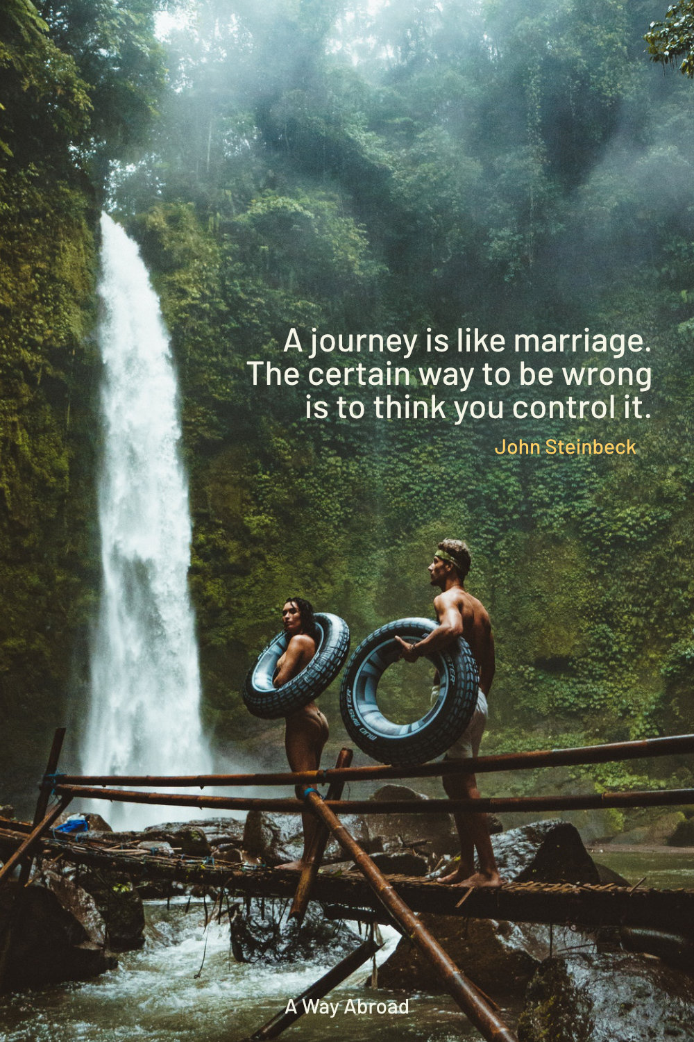 an adventurous travel couple walking through the jungle to a waterfall