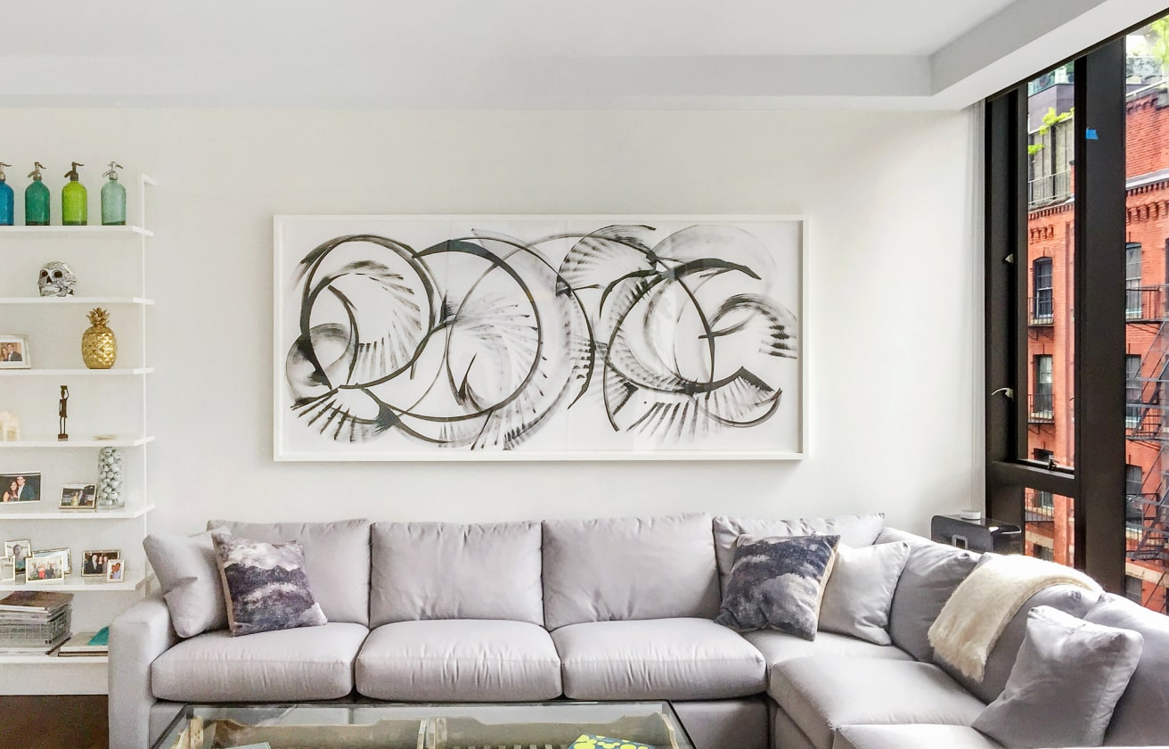 Abstract Art Painting Over A Couch Or Sofa In White And Gray Interior Design