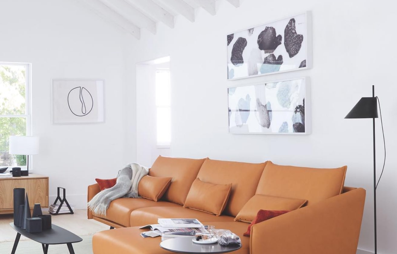 painting over couch art above sofa white orange interior design collect