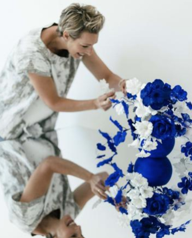 Anna Church putting together a blue and white bouquet on a mirror