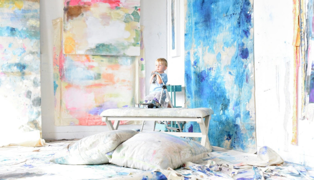 Kiki Slaughter's artist studio near Atlanta with a small child sitting on a bench, immersed in the art