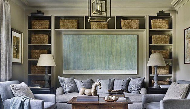 Light blue and green abstract painting by Kiki Slaughter perfectly framed by shelves, lamps, and a couch.