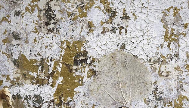 Antique-looking abstract painting with crackled white and brown paint and the trace of a leaf