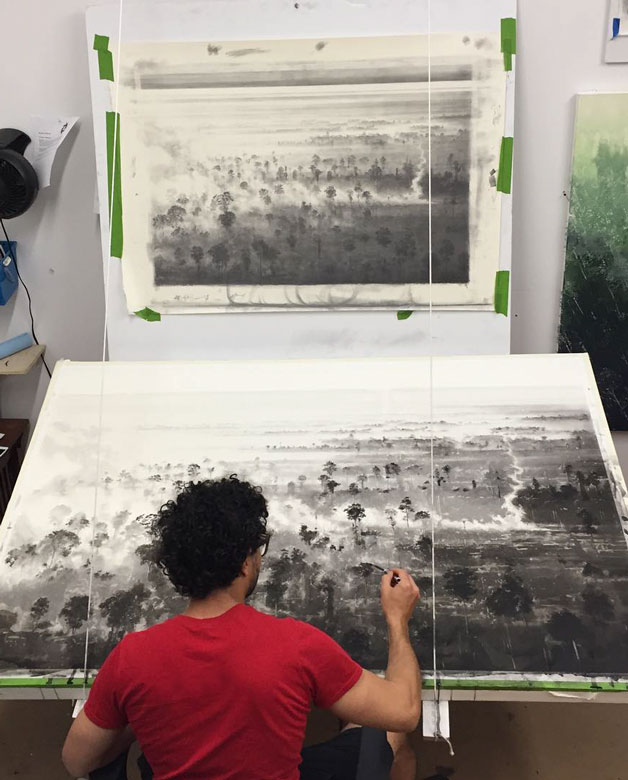 Marcelo Daldoce in his studio working on a large charcoal work of art