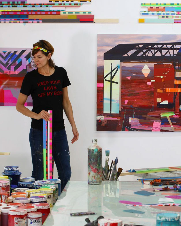 Kristen Schiele in her studio with a Keep Your Laws Off My Books t-shirt