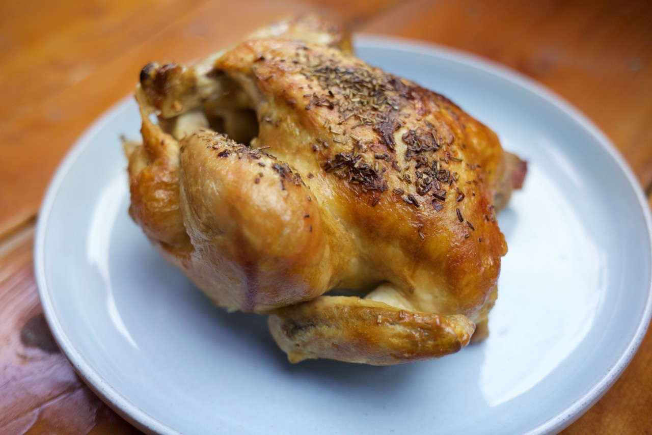 A roasted chicken with a golden brown skin.