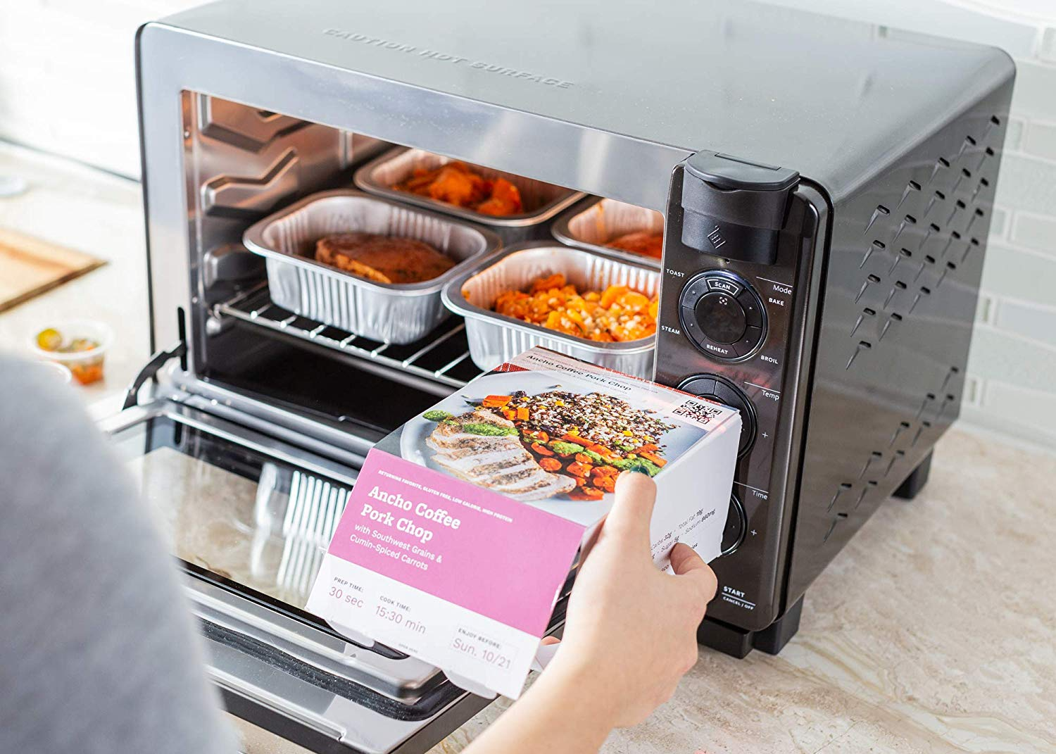 Easy Dinner Ideas for Two: Person about to cook a meal in Tovala Oven