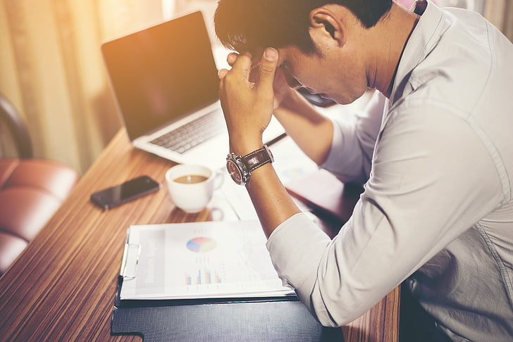 man stressed at work needing burnout treatment