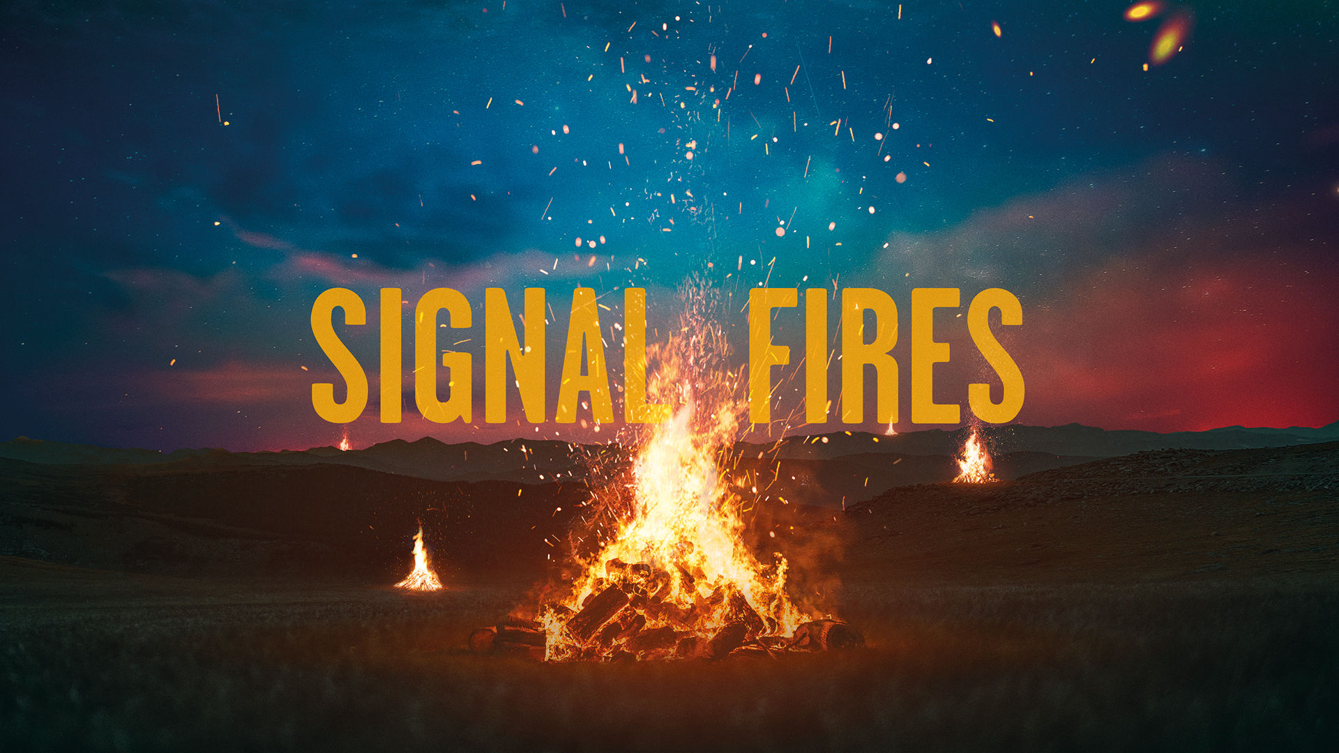 It is dusk with red streaks across the horizon. Before us a blazing bonfire. In the middle distance another. More fires can be seen scattered across a plain towards the horizon. Sparks fly up from the fire. A large yellow title: SIGNAL FIRES