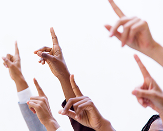 Hands of businesspeople pointing index fingers up
