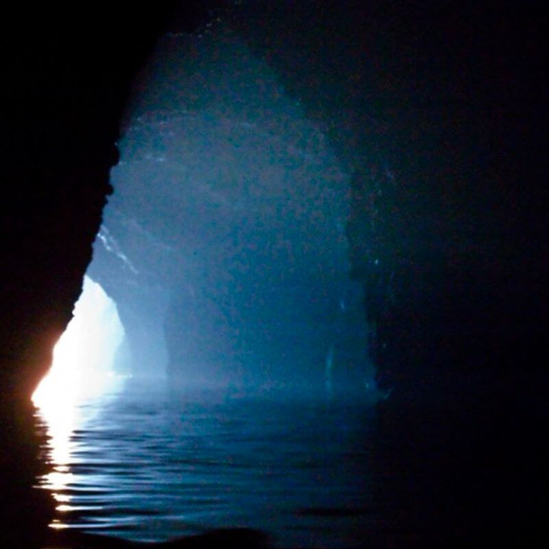 Tunnel with water and light at the end