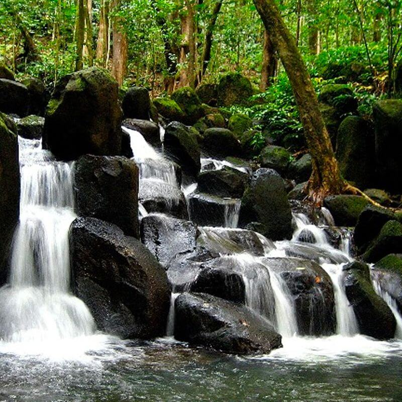 Small waterfalls spill over rocks in a natural landscape