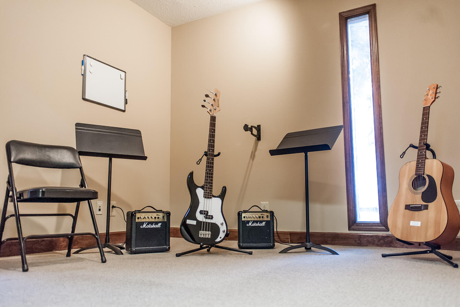 Electric and acoustic guitar lesson room.