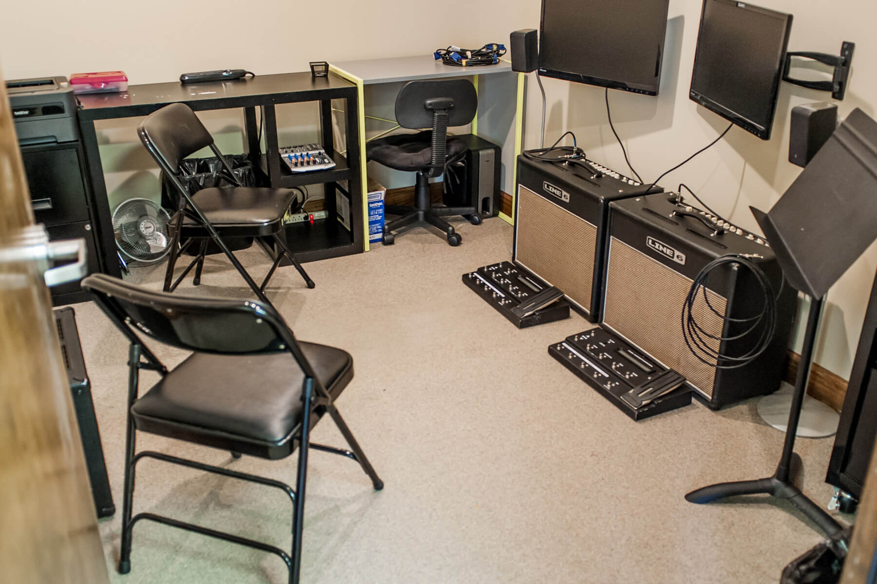 "Practice space with computer monitors and two ""Line 6"" guitar amps."