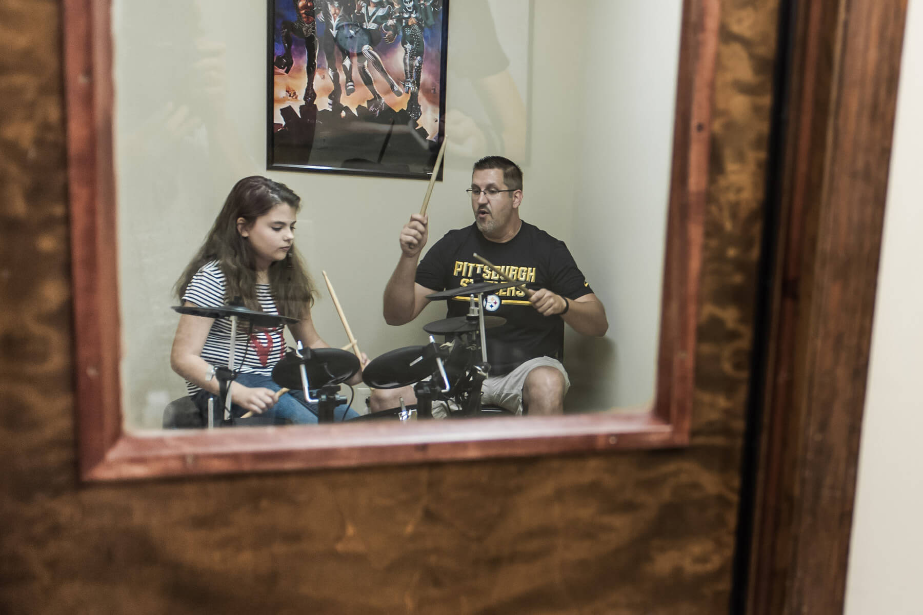 Instructor and student - drum lesson in progress.