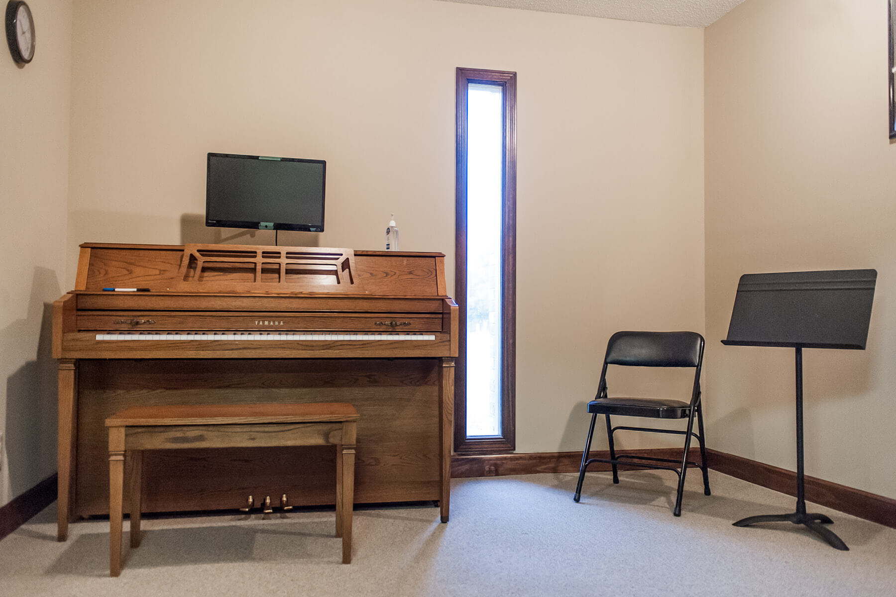 Standing piano lesson room.