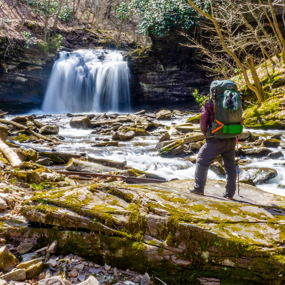 Earl standing in front of a waterfall at Seneca Creek WV
