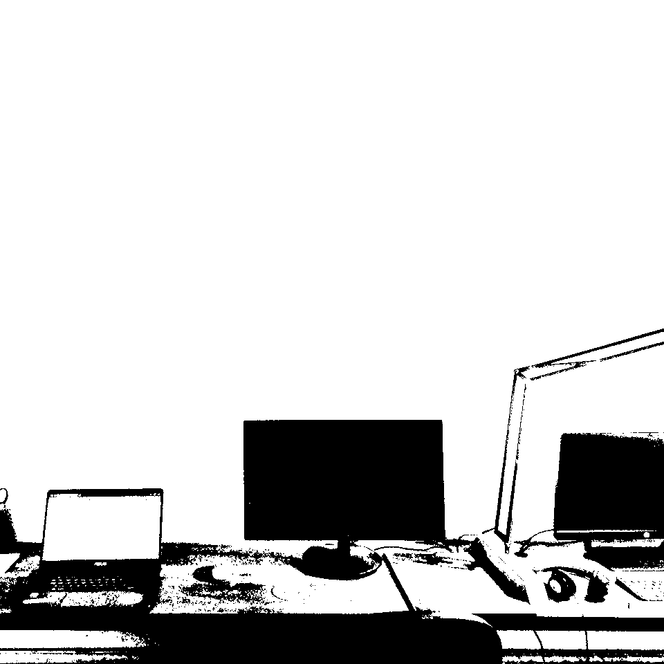 Small Potion - Computers over office desktop