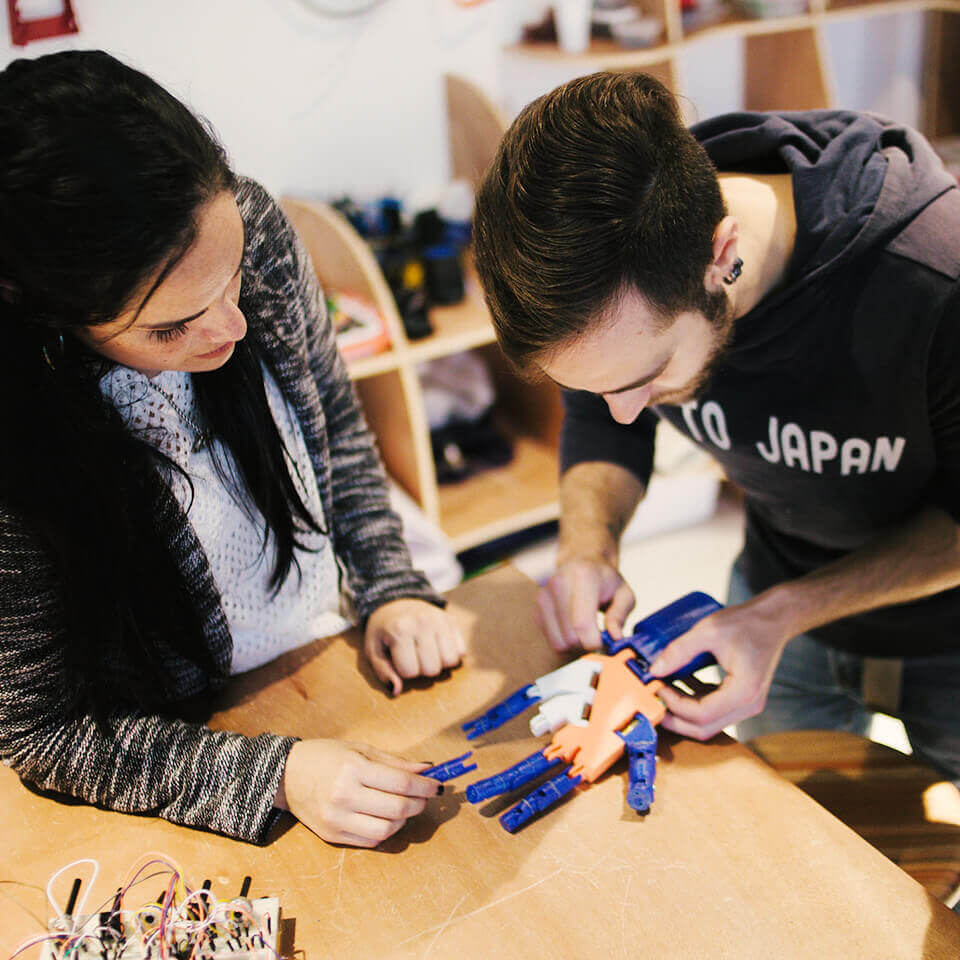 Students working on a robotic hand