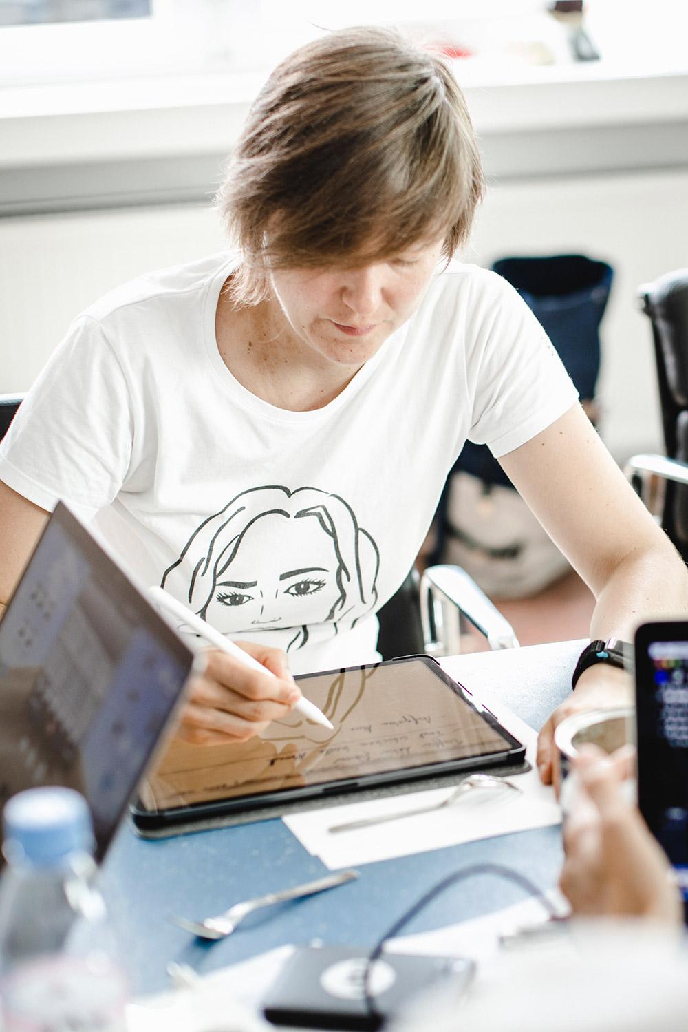 Alice writing on iPad