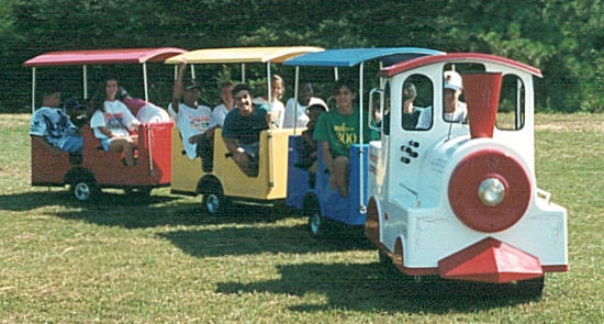 A colorful trackless train that can go on any flat surface. Holds 12 adults or 18 children.
