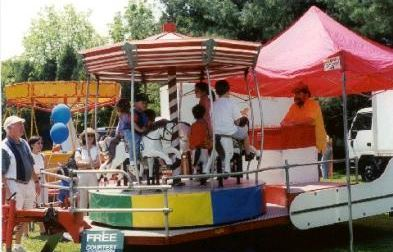 Our Kiddie Carousel will hold up to 6 young children at a time. (10' long x 20' wide x 12' tall)