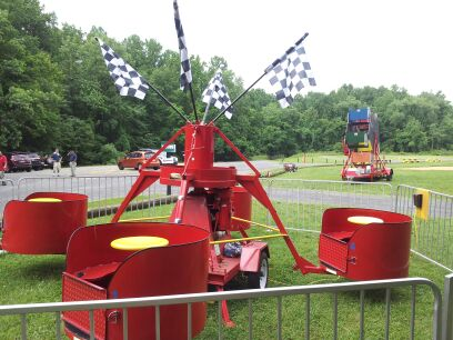 The Tubs of Fun holds up to 12 children at a time. (90 lb weight limit per rider) The ride spins around as the children spin their own tubs at the same time. (25' long x 25' wide x 12' high)