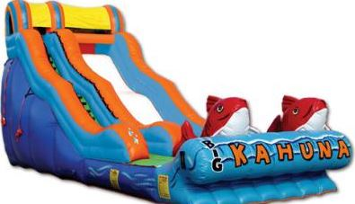 The Big Kahuna™ is an exciting ride from the moment you begin. The midway hump provides huge fun, and the big kahuna's catch you at the end if you make it past the pool. Available as both a dry and water slide. Requires continuous water source. (35' long x 15' wide x 17' tall)