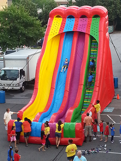 The Triple Lindy is a Large 3 Lane Inflatable Slide Replica of the Old Steel Carnival Slides. Great for Large and Small Events. (40' Long x 17' wide x 26' tall)