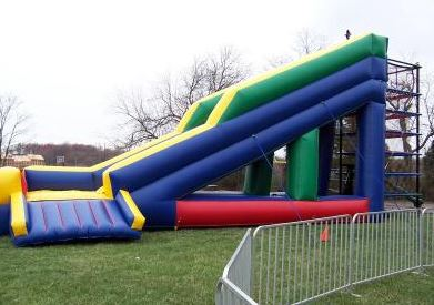 The Spider Zone consists of five interwoven, colorful rubber layers. Children (and adults) are allowed to climb up and down through each layer before exiting the 24' tall slide. (35' long x 10' wide x 24' tall)
