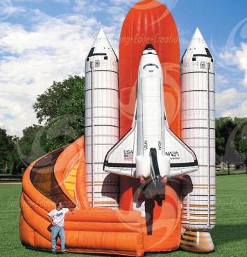 This magnificent Space Shuttle Slide is a 35' tall dual lane slide that is fun for all ages. The Space Shuttle Slide is an eye-catching attraction that is sure to be the centerpiece of your event. (22' long x 22' wide x 35' tall)