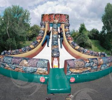 It's a race up a slippery slope - do you have what it takes? Two patrons compete to see who can scale the slope to be the first to ring the bell at the top. One will slide down the victor - the other will slide in defeat! (22' long x 22' wide x 18' tall)