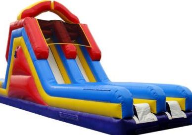 This 18' tall double lane slide can be used as a stand-alone slide or attached to the Regular Obstacle Course to create a 70' long Monster Obstacle Course. (35' long x 13' wide x 18' tall.)