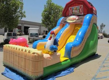 Get ready for some good ol' fun down on the funny farm! Your party guests will go hog wild for the fun barnyard-themed Funny Farm Inflatable Slide. (27' long x 13' wide x 18' tall)