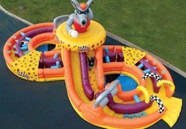 The Rat Race is a figure 8 obstacle course featuring a tire run, squeeze-plays, tackle dummies, tunnels, and a giant slide. (60' long x 30' wide x 24' tall)