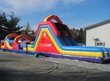 The Monster Obstacle Course inflatable play structure has a round front-loading obstacle entrance, taking participants through maneuvering pop-ups, over climbs, and down the slides, through the pair of tunnels before climbing the large slide for an awesome sliding experience making for an exciting race from start to finish. (70' long x 12' wide x 18' tall)
