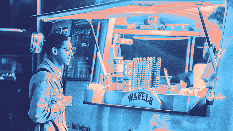 Blue gradient image of man looking at waffle truck stand